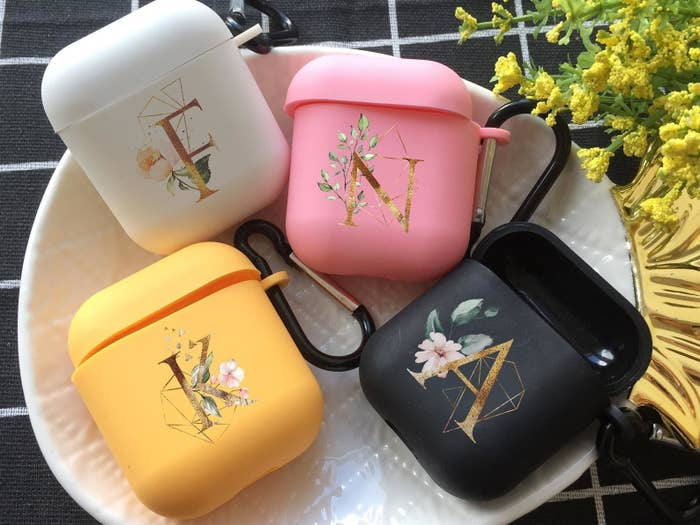 AirPods cases with gold monogram letters and floral prints