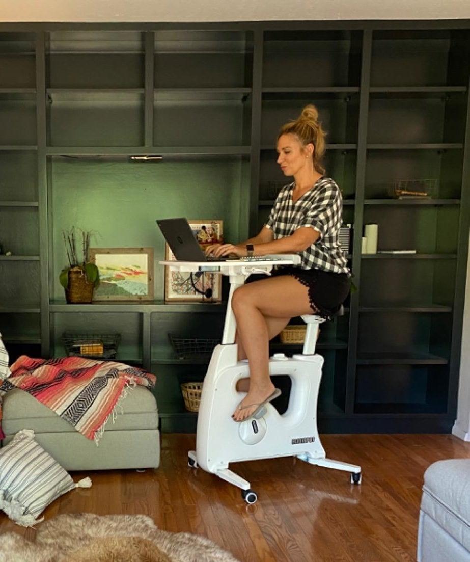 Reviewer sitting on bike desk