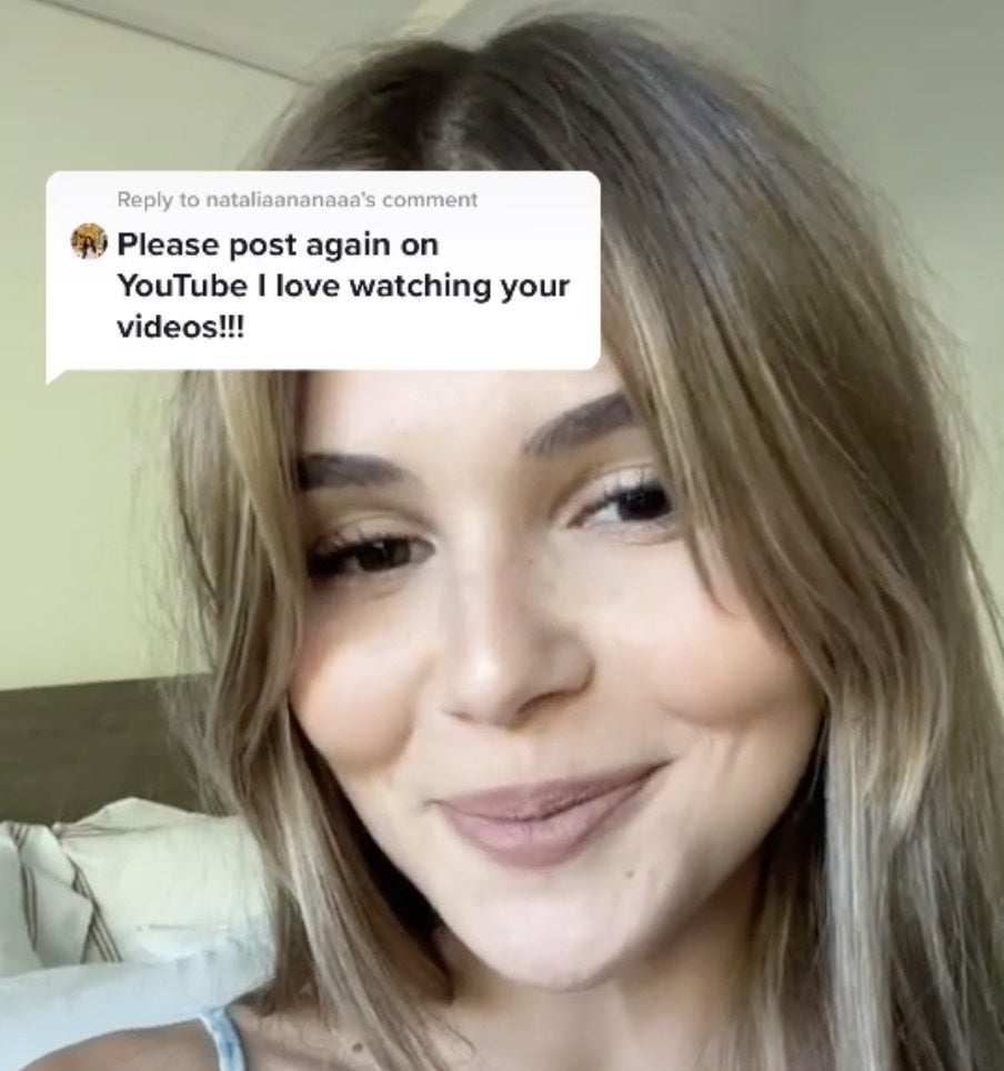 Olivia smiles next to a screenshot of a positive comment