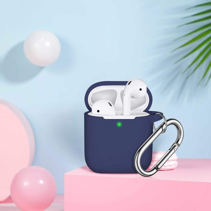 AirPods placed in blue silicone case with carabiner