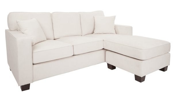 The couch in white, which is a traditional 3-seat sofa with an ottoman extension on one seat