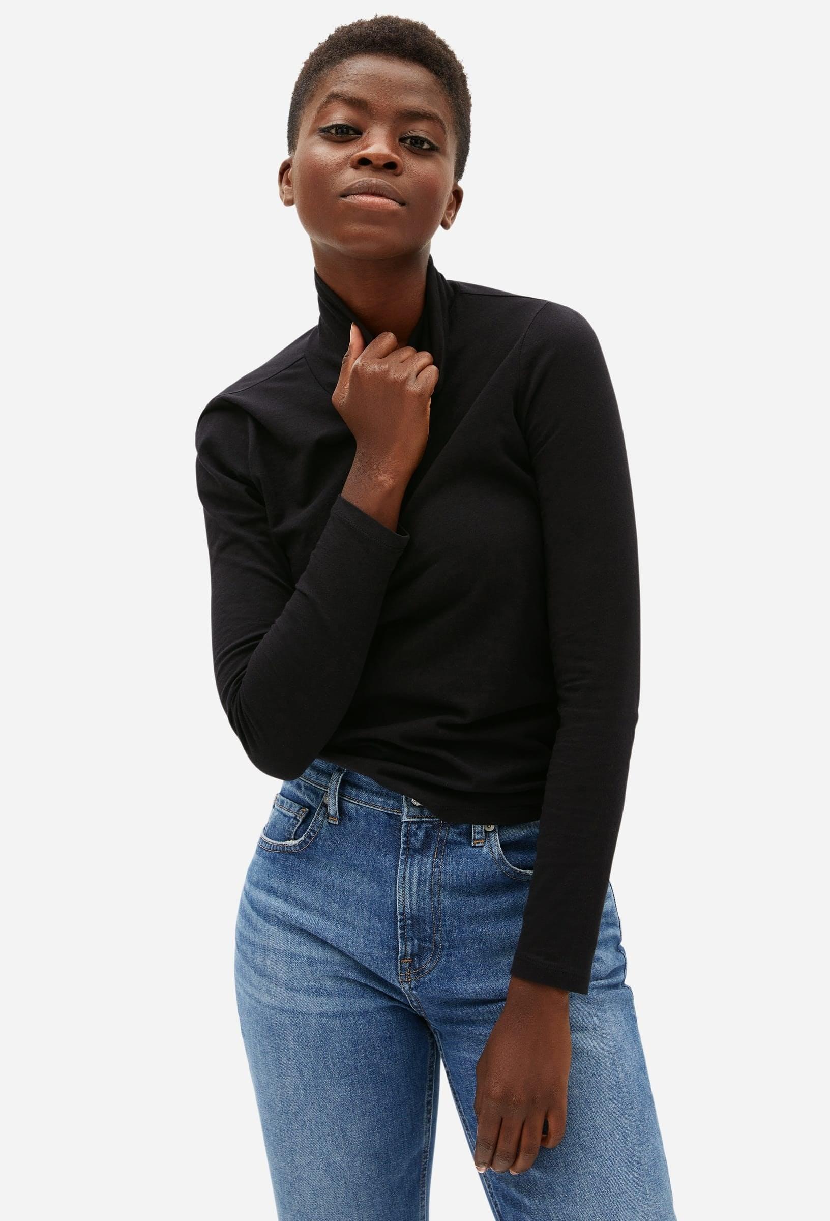 Model wearing the turtleneck