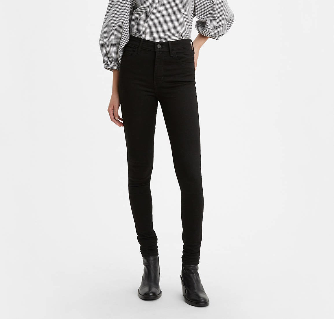 a model wearing the high-rise skinny jeans in black