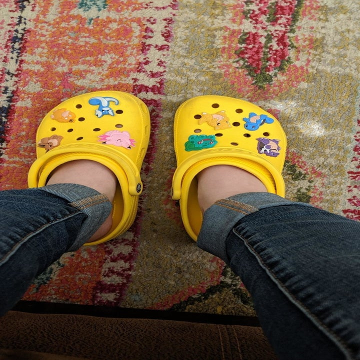 A reviewer wearing the shoes in lemon yellow