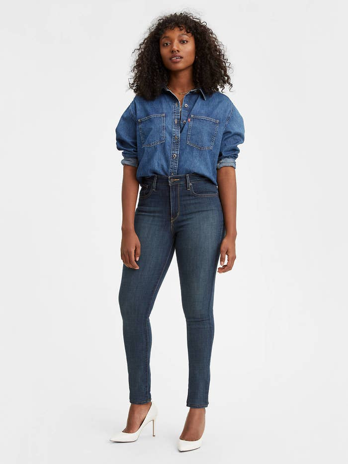 a model wearing the dark wash high-rise pants