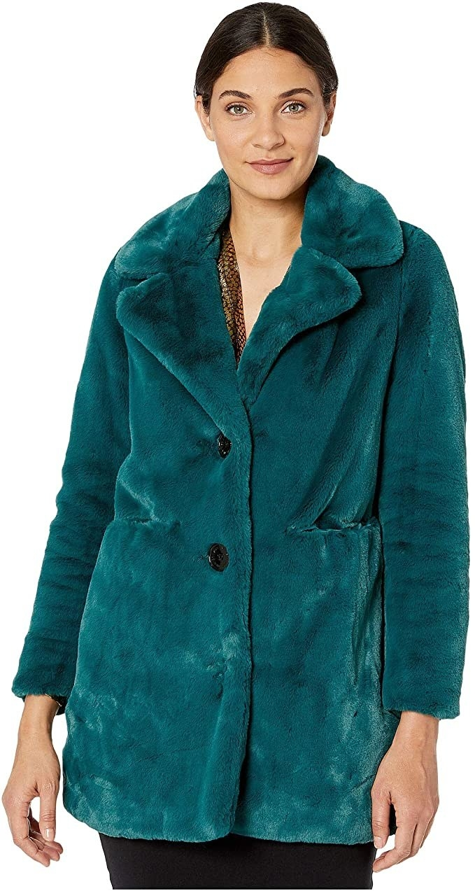 A model wearing the button-front, teal, fuzzy coat