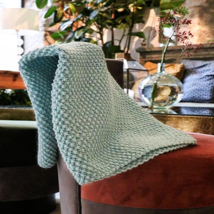 a blue knit blanket