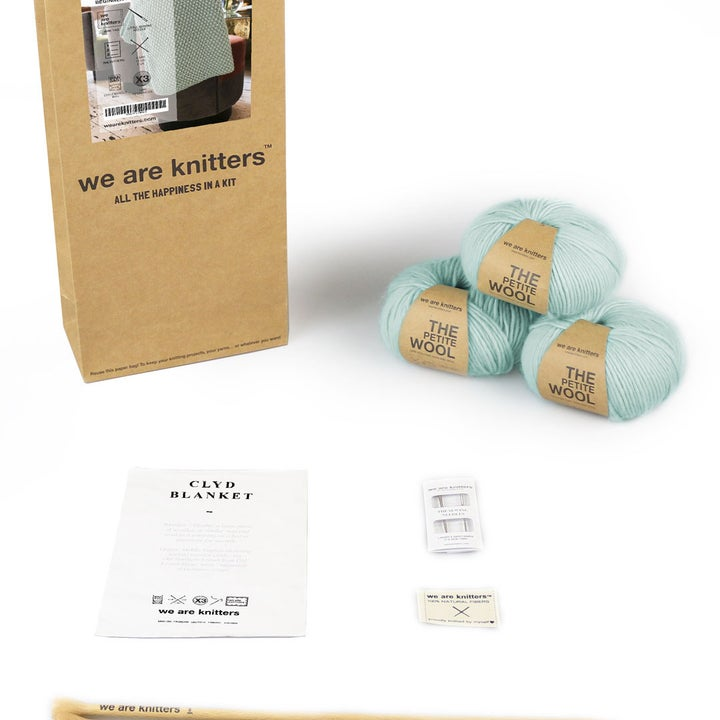 the knitting set with yarn, needles, and instructions