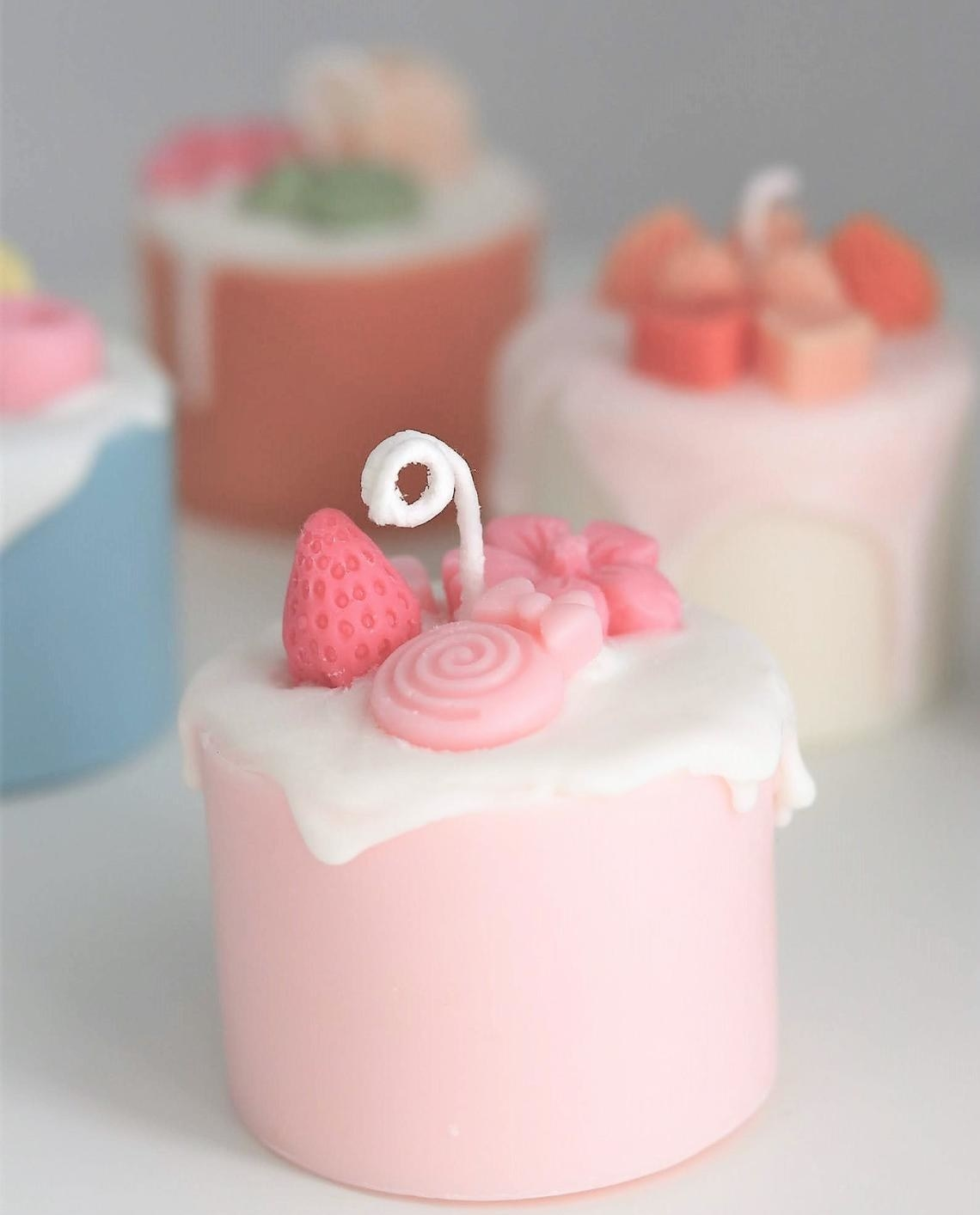 A small candle in the shape of a cake