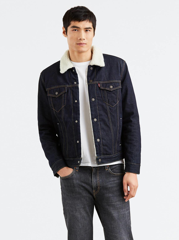a model wearing the sherpa=lined jacket in dark wash
