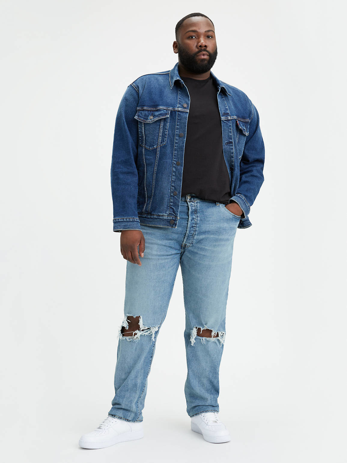 a model wearing the jeans which have a rip in the knee