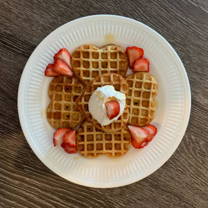 mini heart shaped waffles with strawberries on a plate