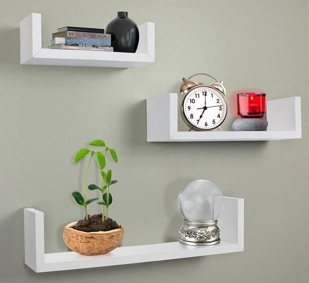 "The shelves, which are white and have a ""U"" shape, with small shelves on either end"
