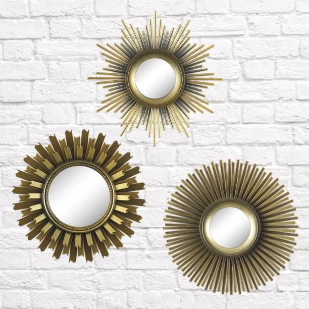 "The three mirrors, which all have a round mirrored center, and various ""sunburst""-style gold-toned embellishments"