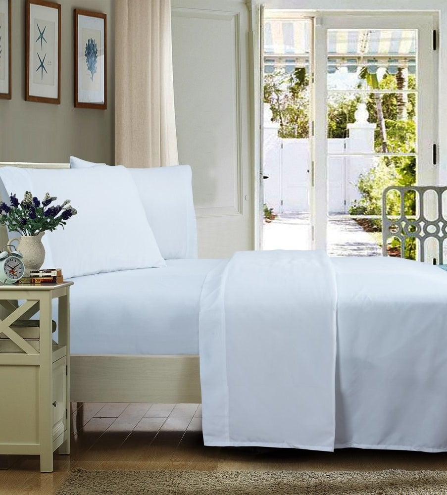 a white set of wrinkle-free sheets on a bed