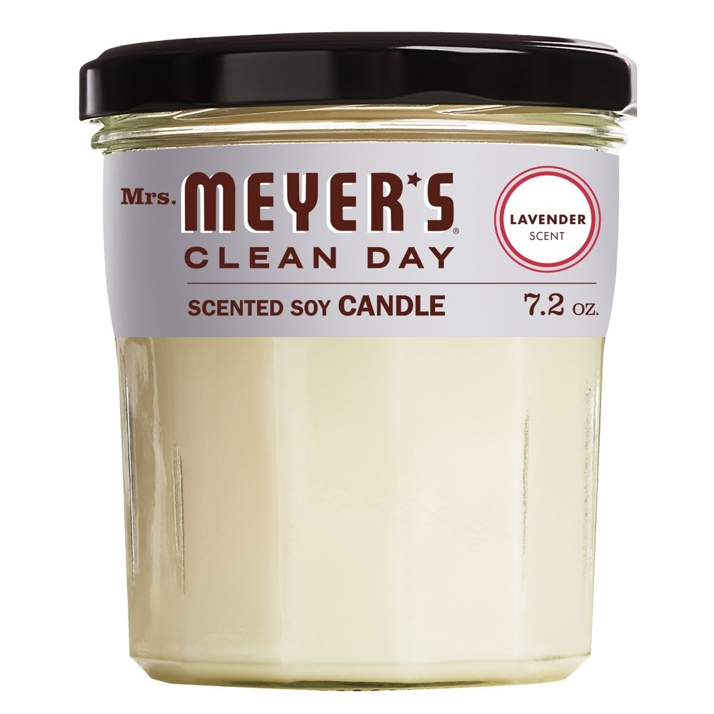 """a glass candle jar with a purple label and text that reads """"mrs. meyer's clean day scented soy candle, lavender scent"""""""