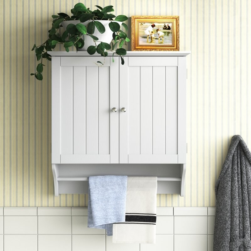 Wall mounted cabinet in bathroom.