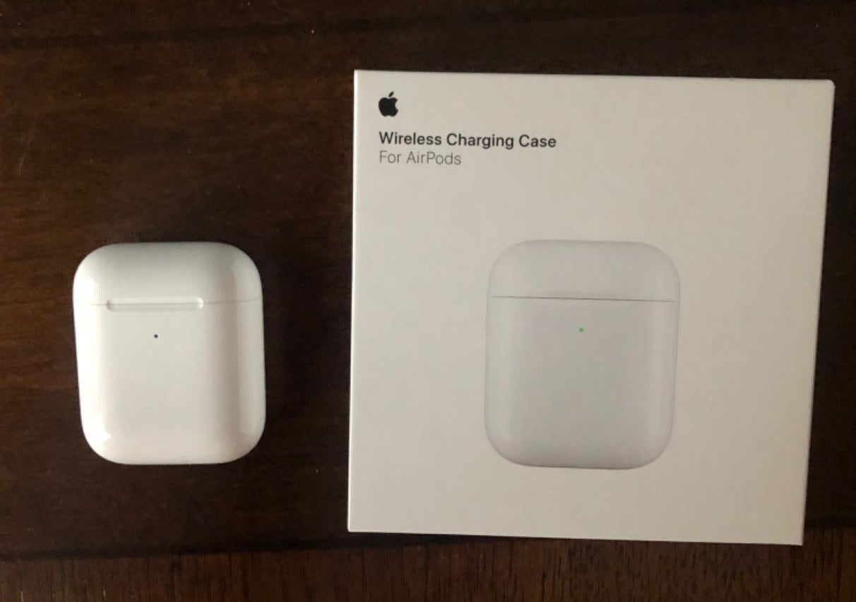 Amazon reviewer photo of AirPods wireless charging case next to product box