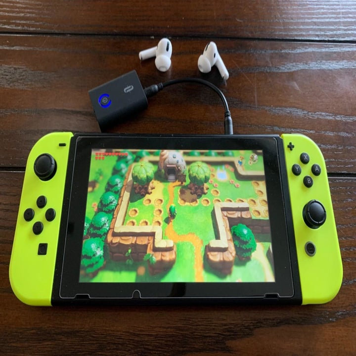 Amazon reviewer photo of Bluetooth transmitter connected to Nintendo Switch