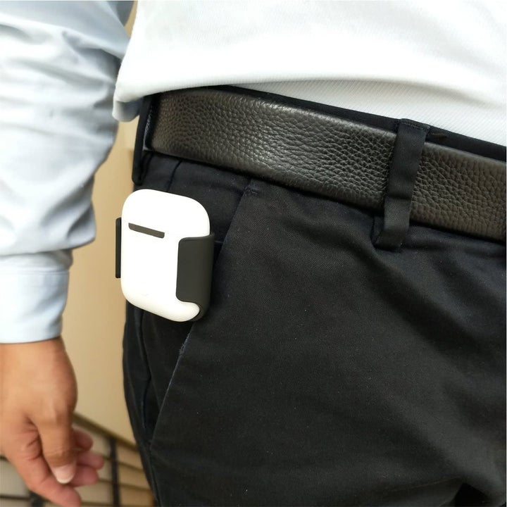 Model wearing AirPods belt holder attached to their pocket