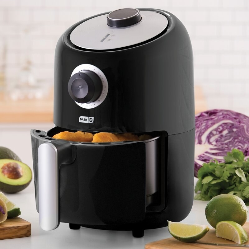 Air fryer with food in it.