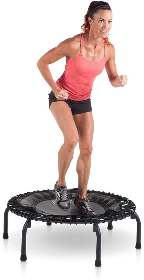 Person jumping on small trampoline with springs covered