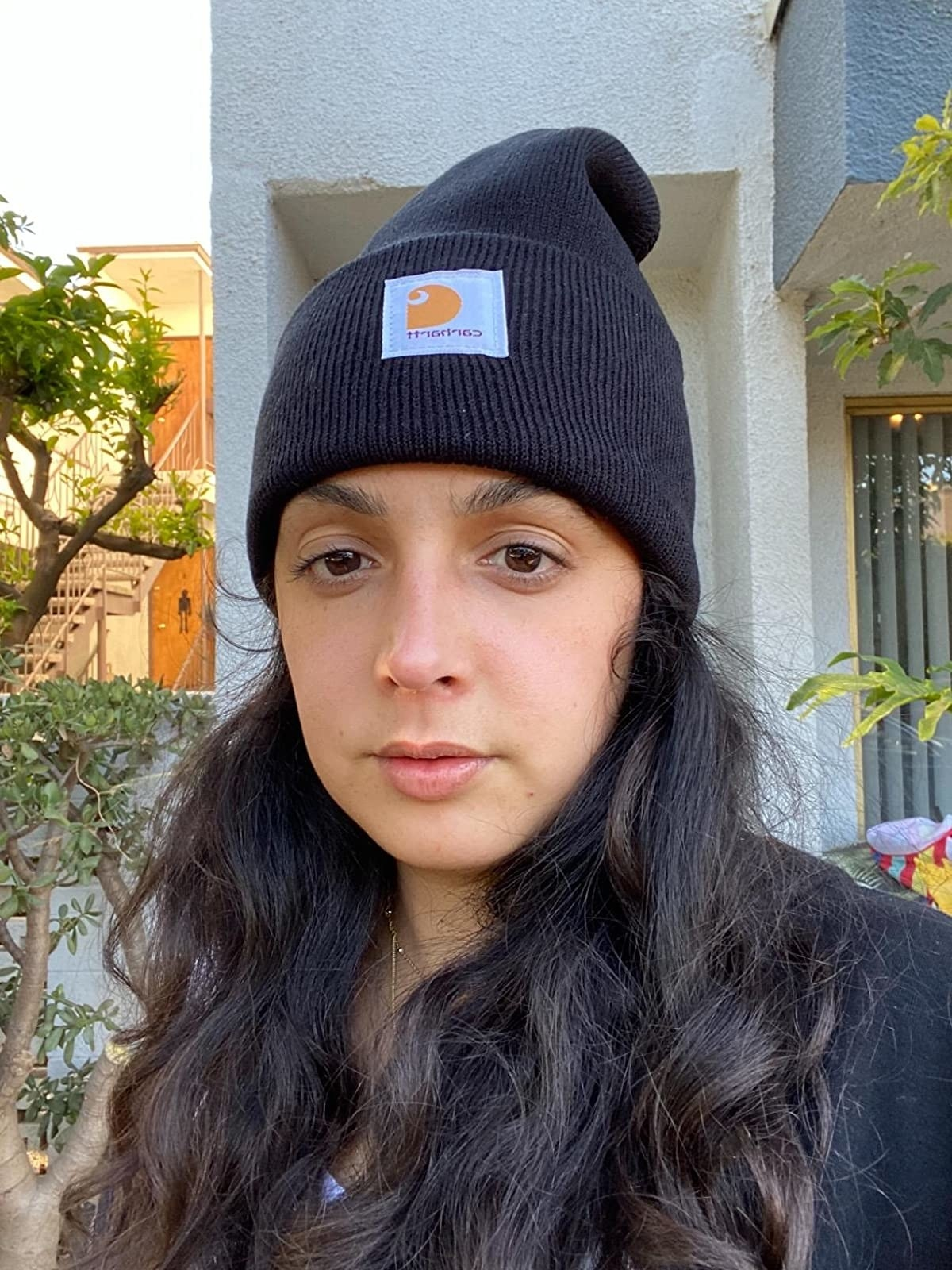 Reviewer wearing the black beanie