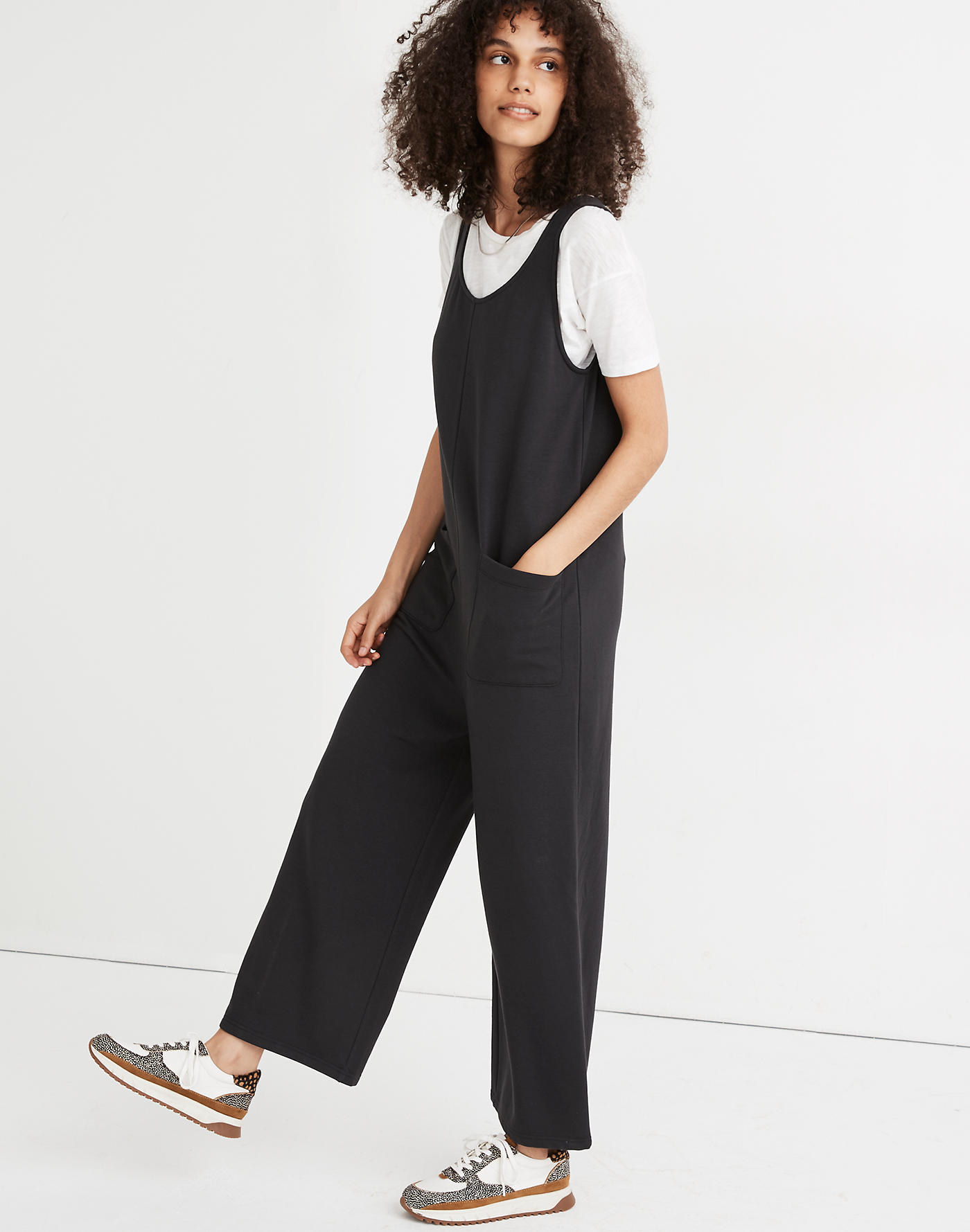 Model wearing short-sleeved jumpsuit with pockets
