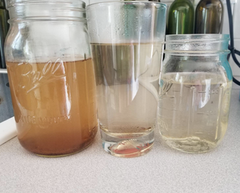three cups of dirty water that get progressively cleaner with each rinse