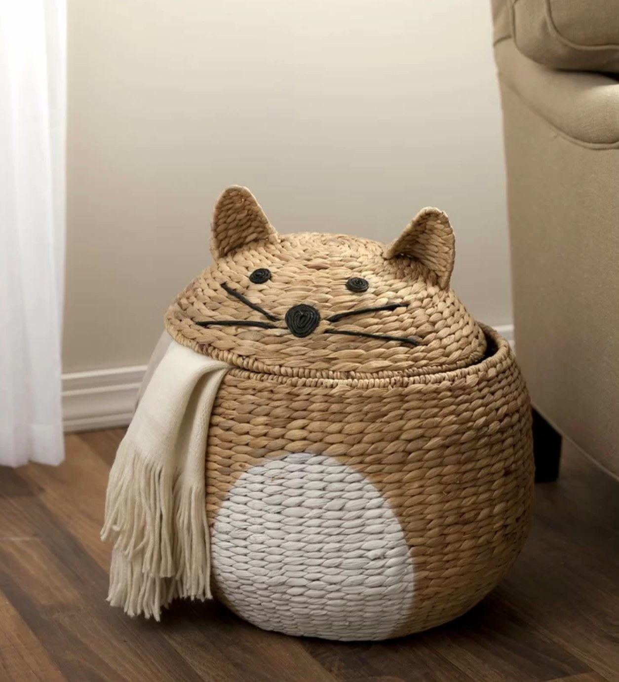 Cat-shaped basket with white scarf inside