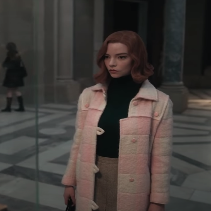 """Beth in """"The Queen's Gambit"""" wearing pink checkerboard coat"""
