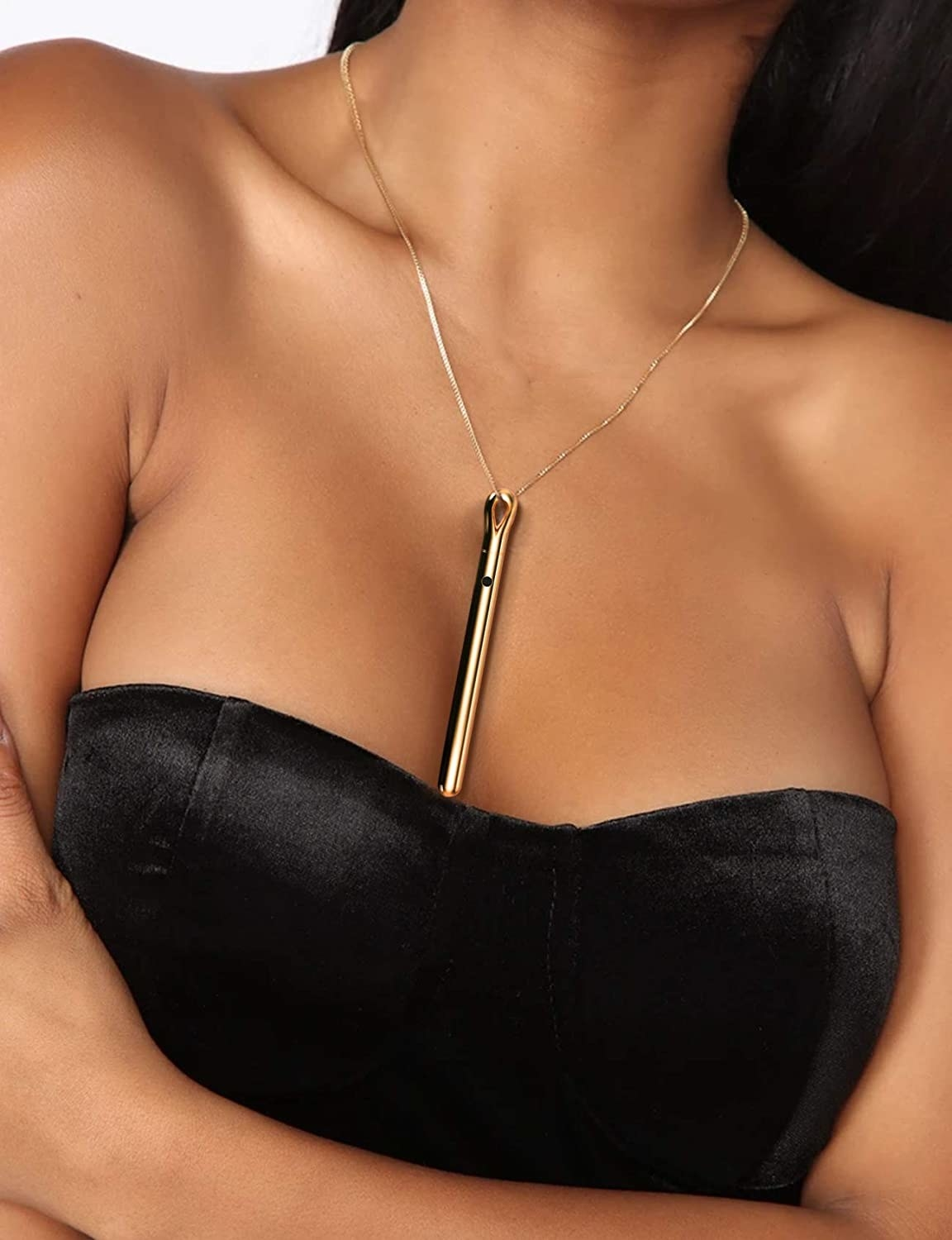 close up of the Long Gold Plated vibrator necklace hanging from a model's neck