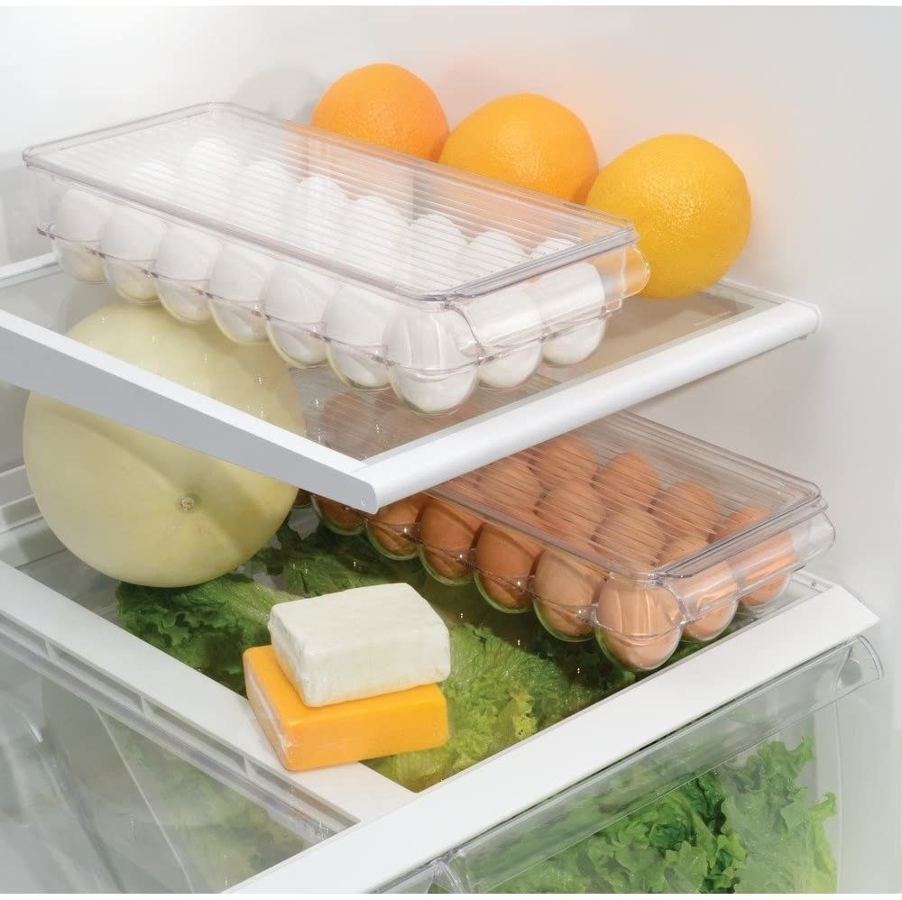 Two egg boxes in a fridge