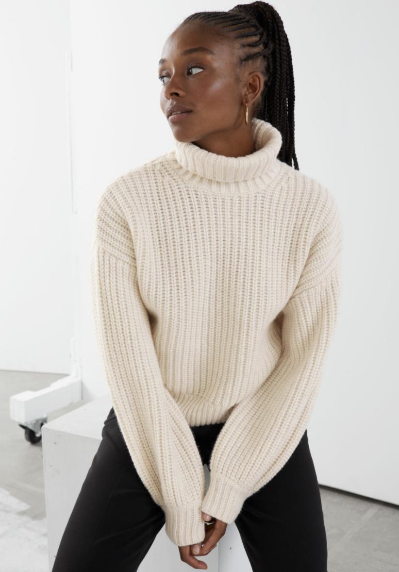 Model wears balloon sleeve knit sweater