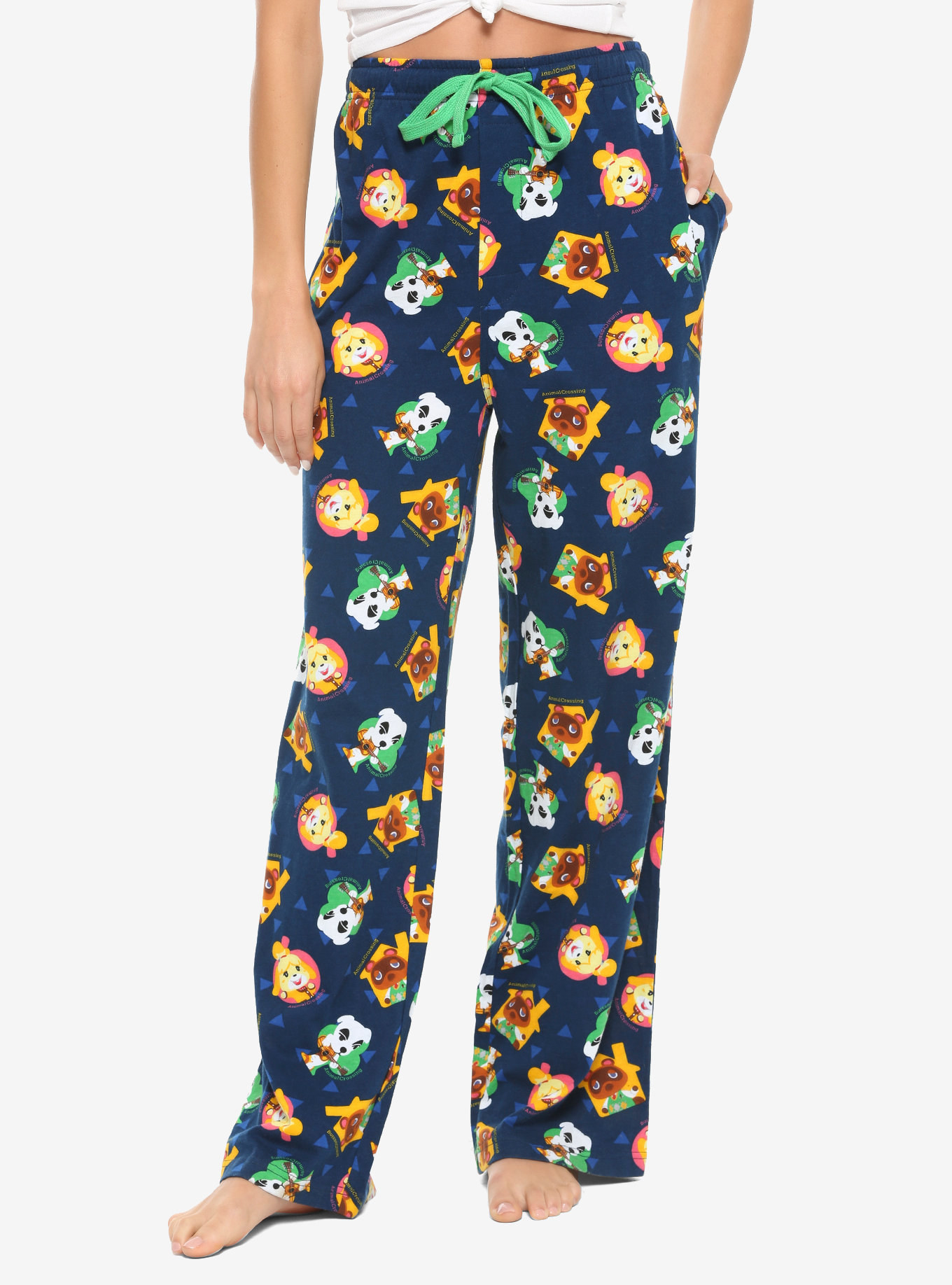 a model wearing blue pajama pants with characters from animal crossing all over them