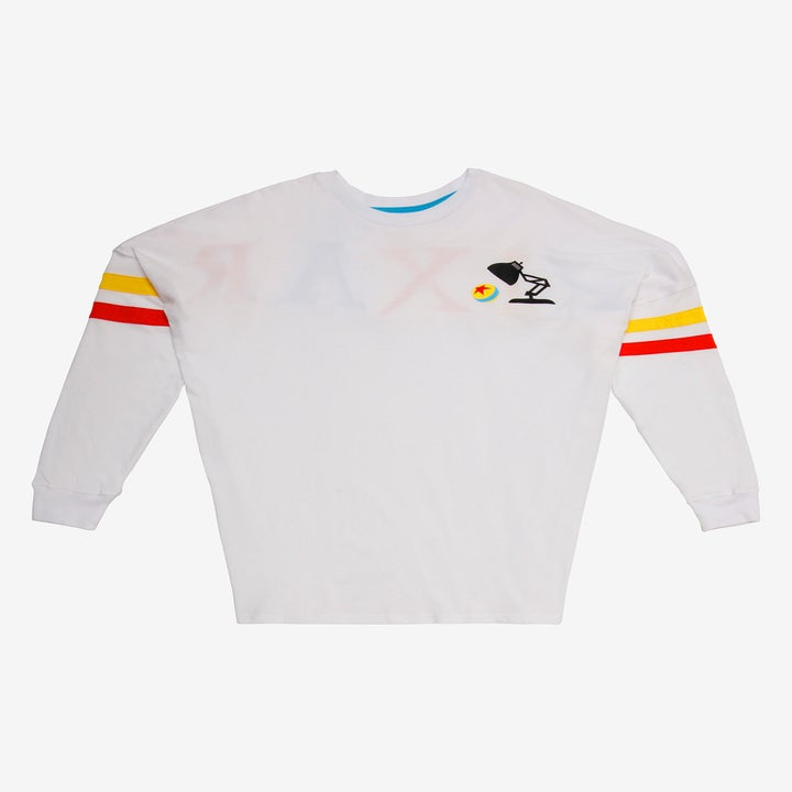 the long sleeve top with the luxo lamp and pixar ball icon and a red and yellow stripe on each sleeve