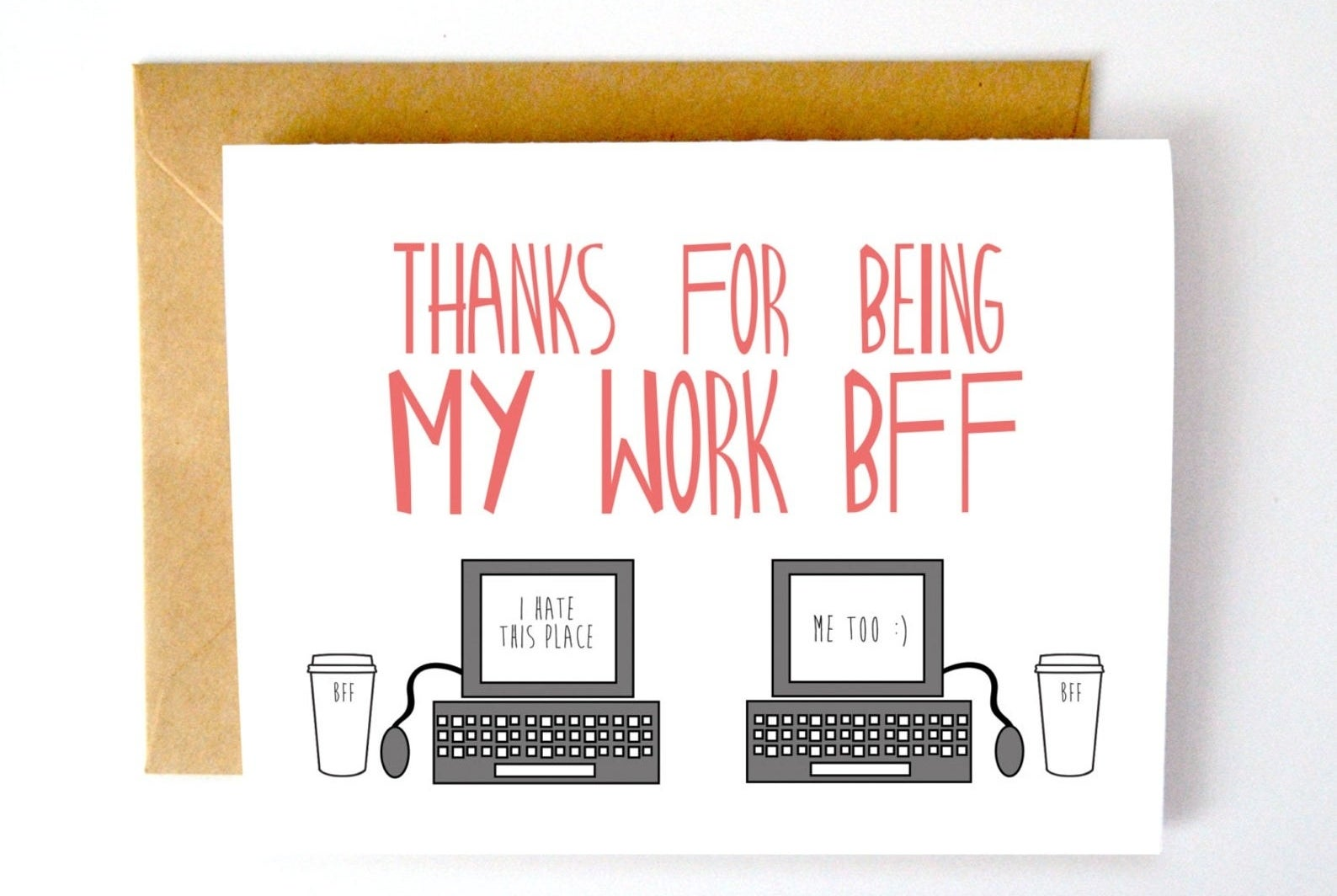 """A white card with """"Thanks for being my work BFF"""" in red type, with two drawings of computers—one says """"I hate this place,"""" the other says """"Me too :)"""""""