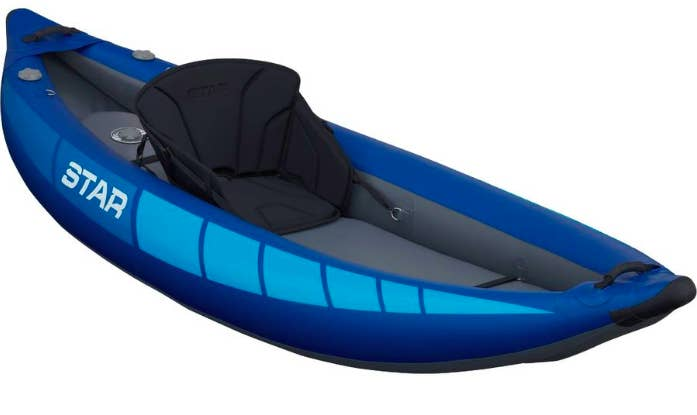 Inflatable kayak with attached seat in center