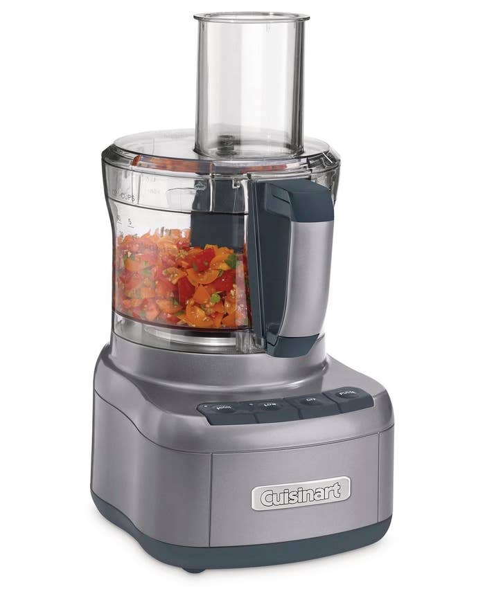 cuisinart food processor with tomatoes chopped up inside