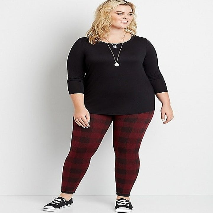 a model in buffalo check red and black leggings