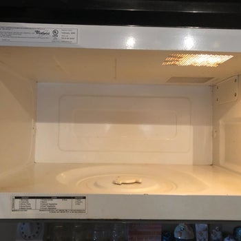 The reviewer's after photo which shows all the spots are gone and the microwave is clean