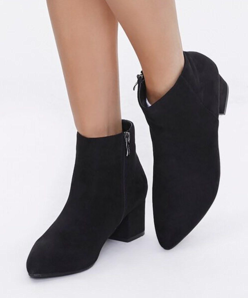 Model is wearing black booties