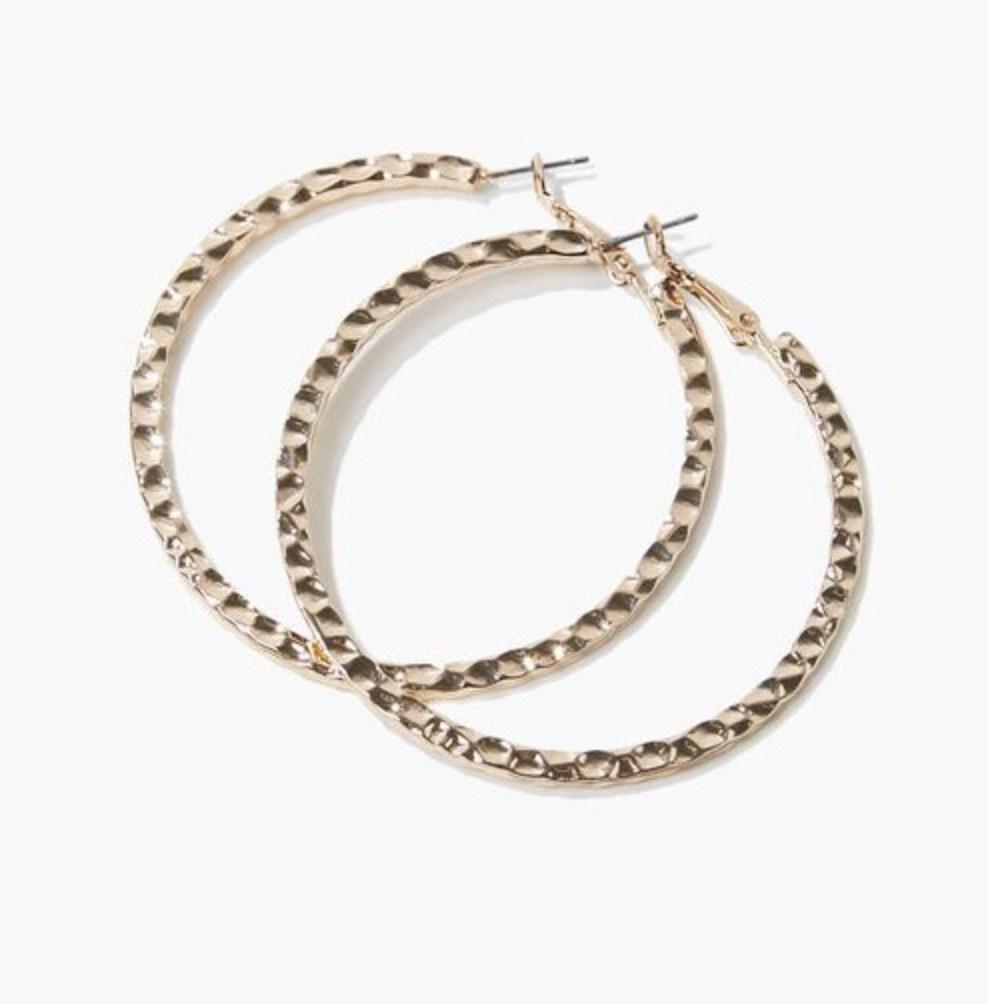 The gold hoop earrings