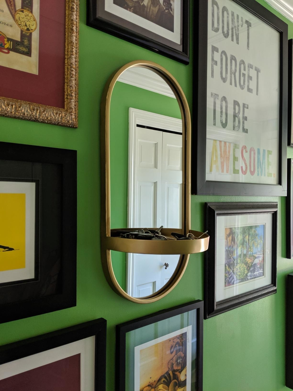 reviewer image of the gold kate and laurel modern metal wall mirror with shelf