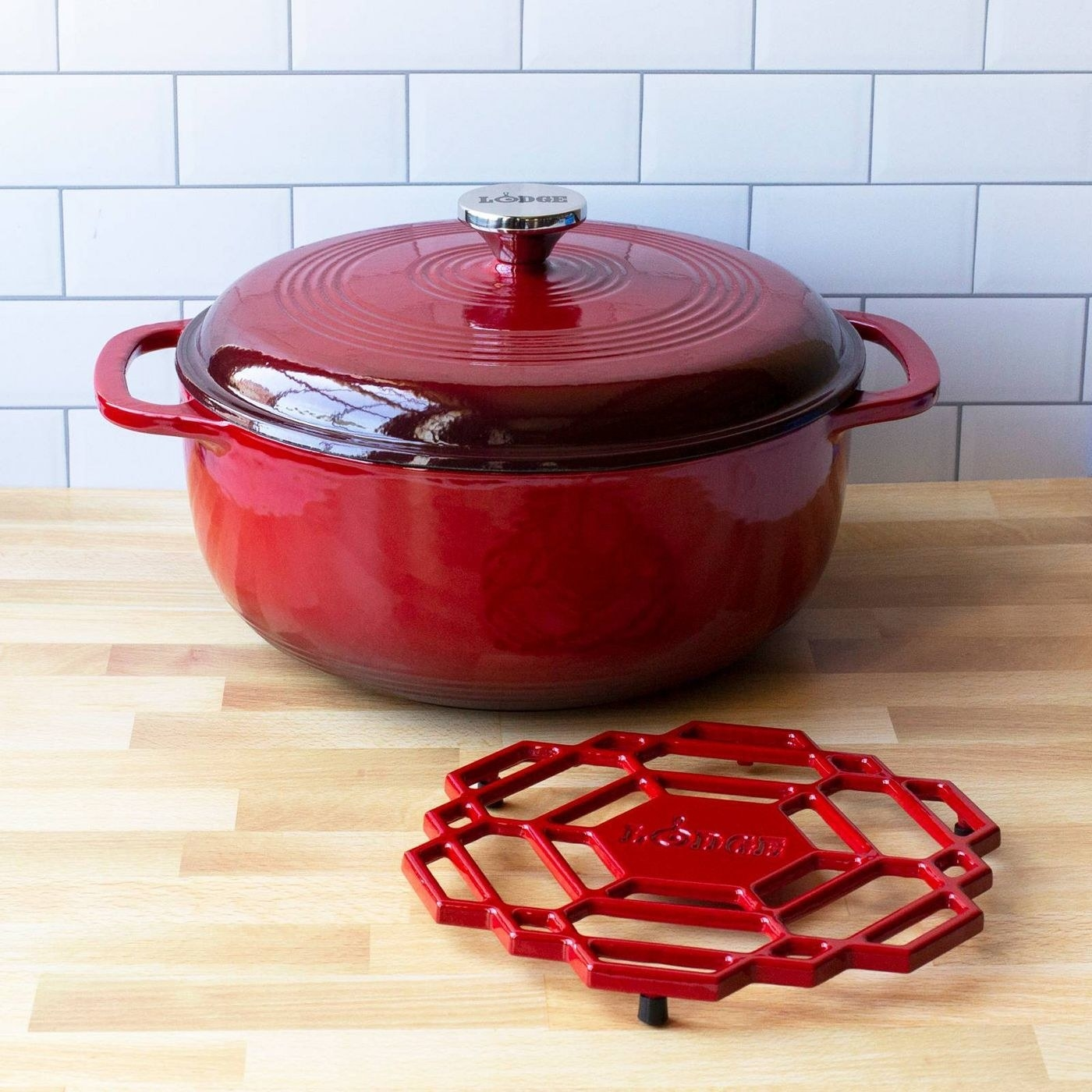 red lodge dutch oven with a matching trivet