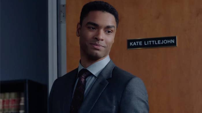 Leonard standing in front of Kate's office