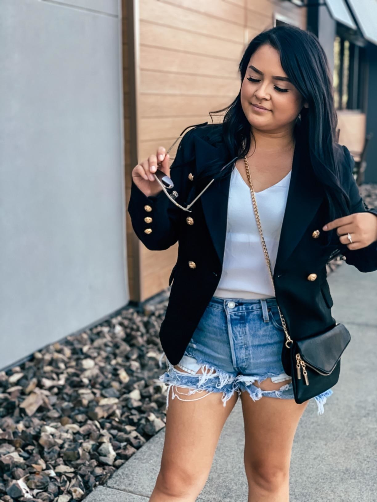 reviewer wearing the blazer in black
