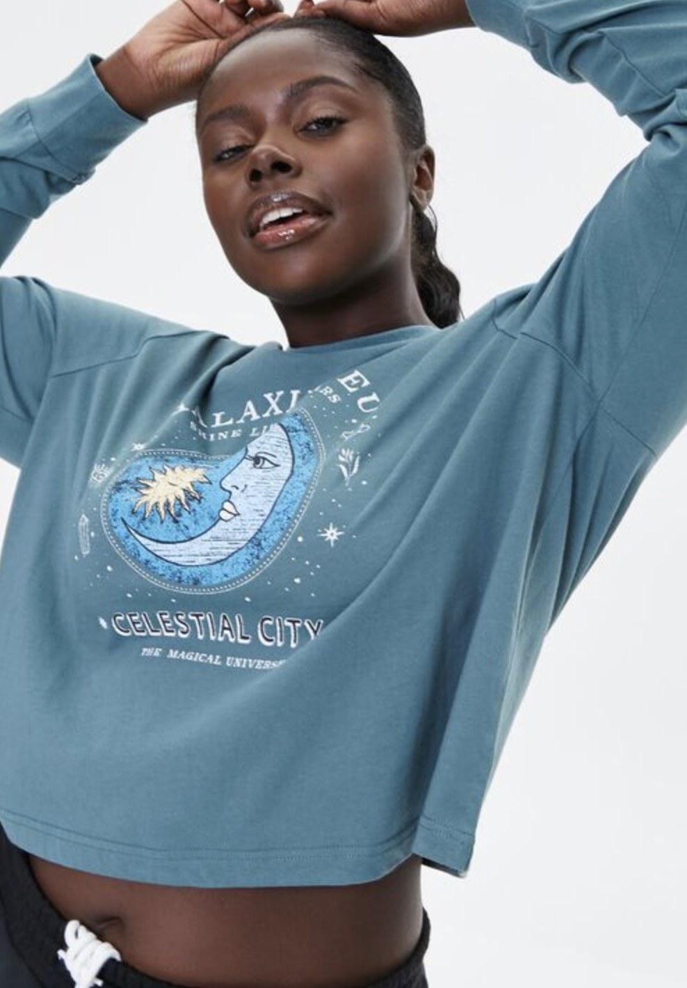 Model is wearing a pale blue sweatshirt