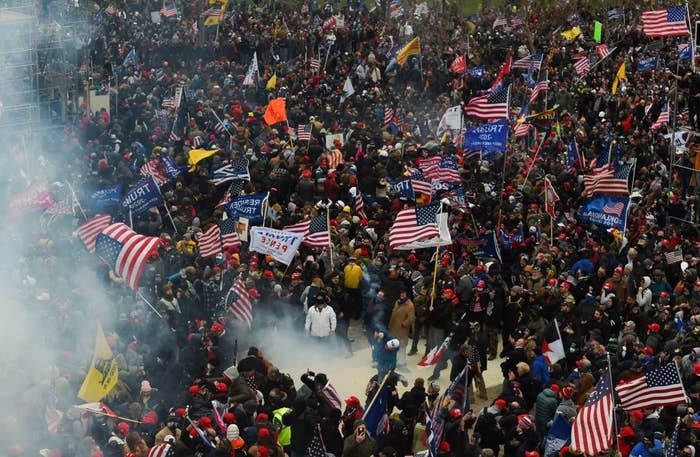 Large crowd of rioters holding U.S. flags and 'Trump/Pence' flags