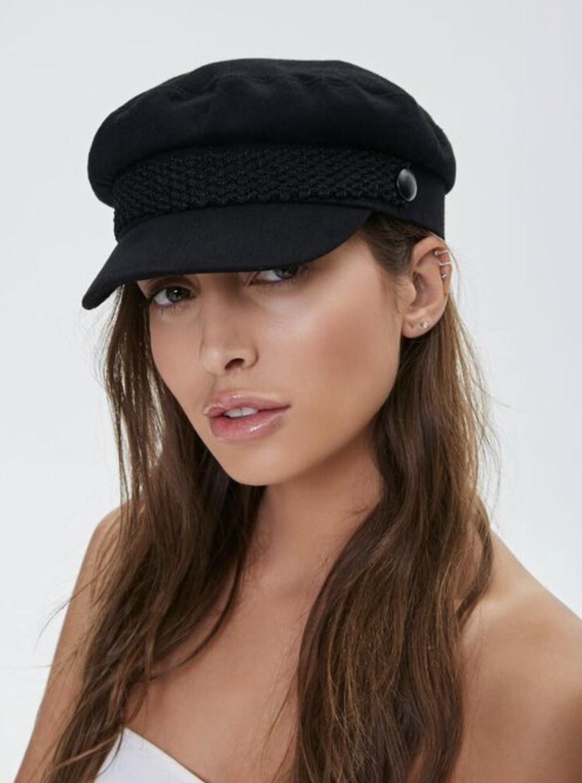 Model is wearing a black cabby hat
